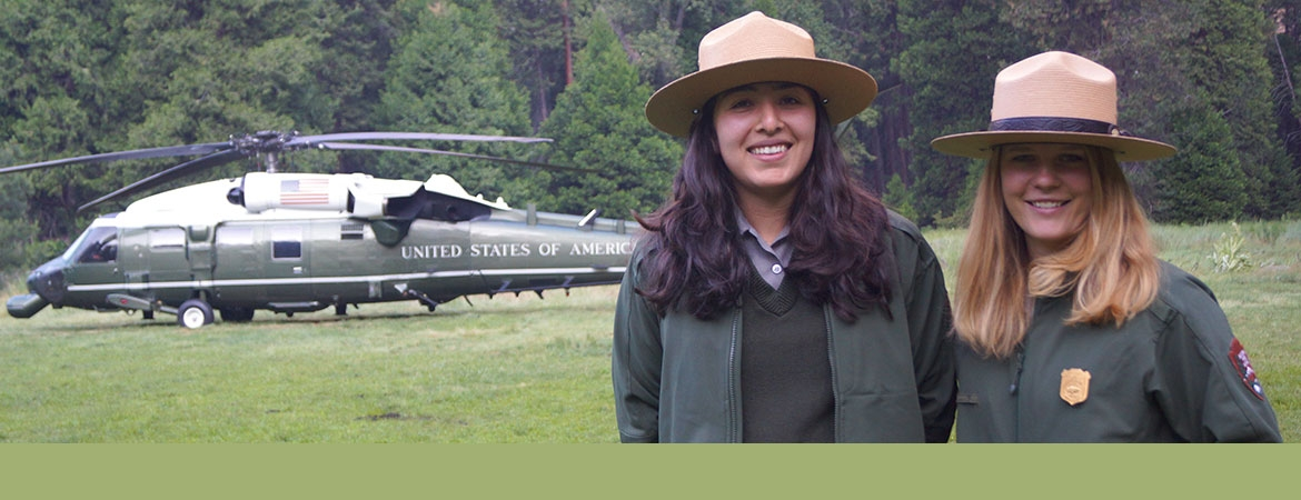 A UC Merced alumna and student pose in front of the helicopter that brought President Obama and the first family to Yosemite National Park in June 2016.
