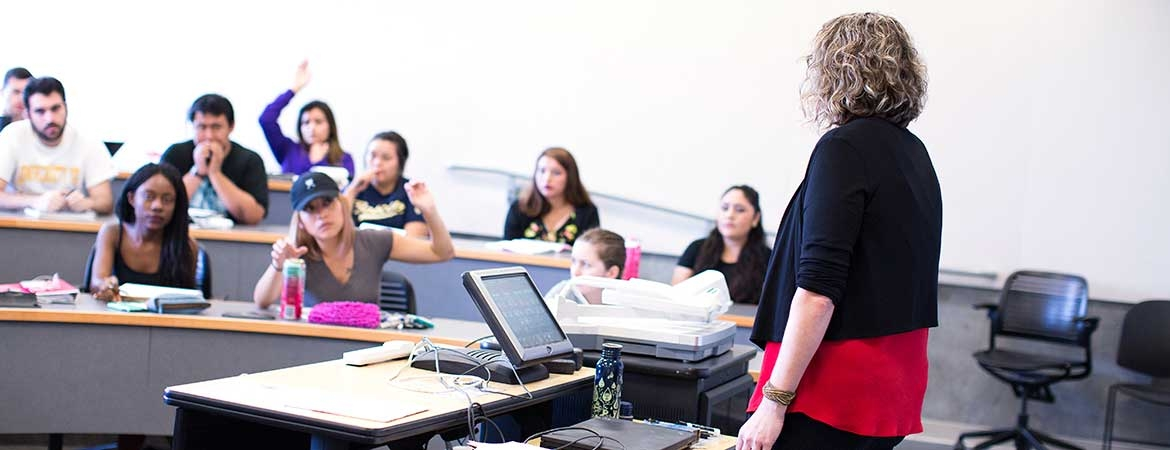 UC Merced students engage in a classroom discussion with a faculty member.