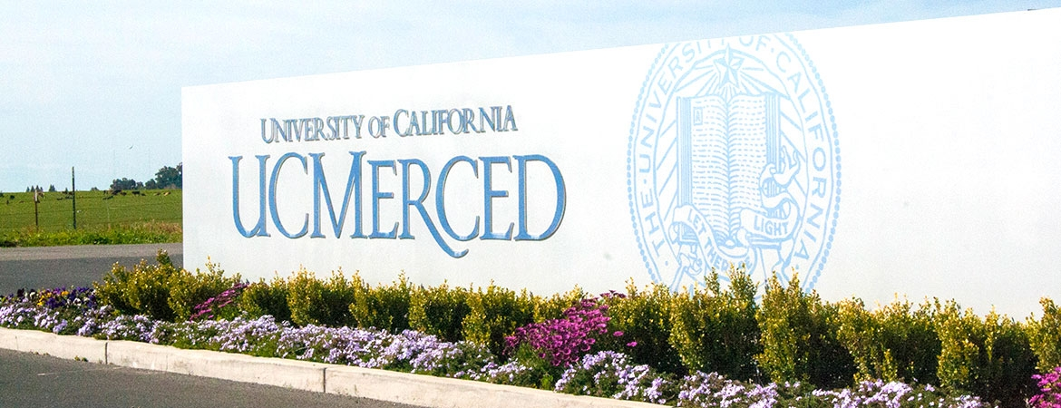 UC Merced's sign, adorned with the University of California seal, decorates the main entrance into the campus.