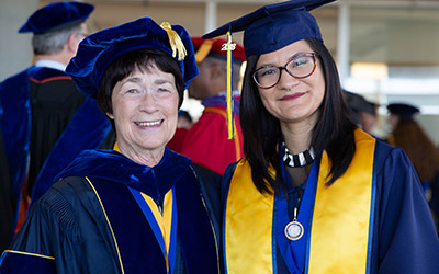 Chancellor Leland with student speaker Santana Juache.